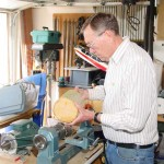 Jim putting a large avocado log on a small lathe