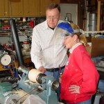 Jim helping Barbara shape the outside of the vessel