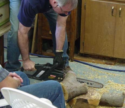 Lyle says the chainsaw is safer than a bandsaw for cutting wet wood logs. Here he is trimming the crotch to the size he wants for the approximate diameter of the bowl and the capacity of the 16