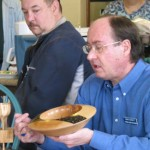 Russ with maple platter discussing surface decoration