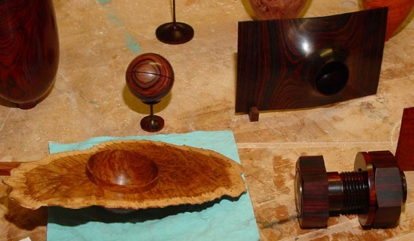 Winged bowls, Spherical Box on stand, and threaded box.