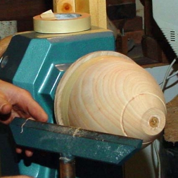 Bowl mounted on jam chuck and secured with masking tape. Note the shoulder used by the 4-jaw chuck