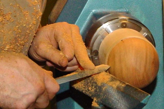 Removing the last pencil marked flat of the groove with the beading tool as a scraper