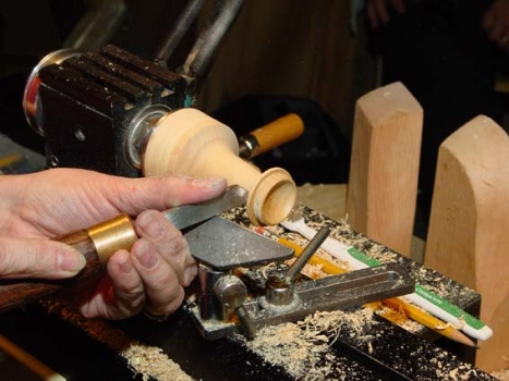 A skew chisel is used to smooth out the end grain on the top surface