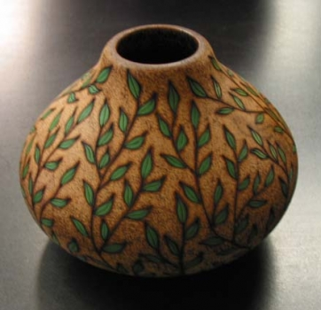 Example of hollow form decorated with pyrography, coloring and texturing