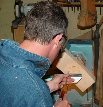 Cutting the tenon on bottom.