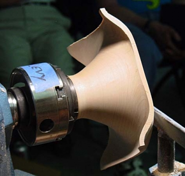 The base is secured in the 4-jaw chuck using the tenon.