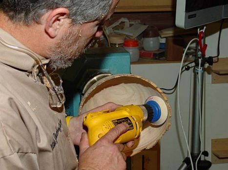 Sanding the now hollowed-out bowl.