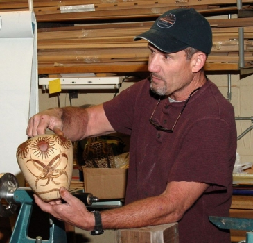 Sven shows off one of his woodburned Norfolk Island Pine hollowform