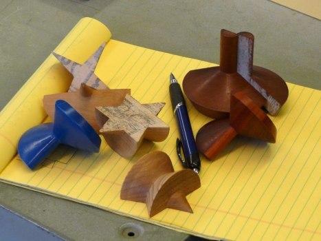 Various shaped steptohedrons showing split turnings and newspaper and glue joints