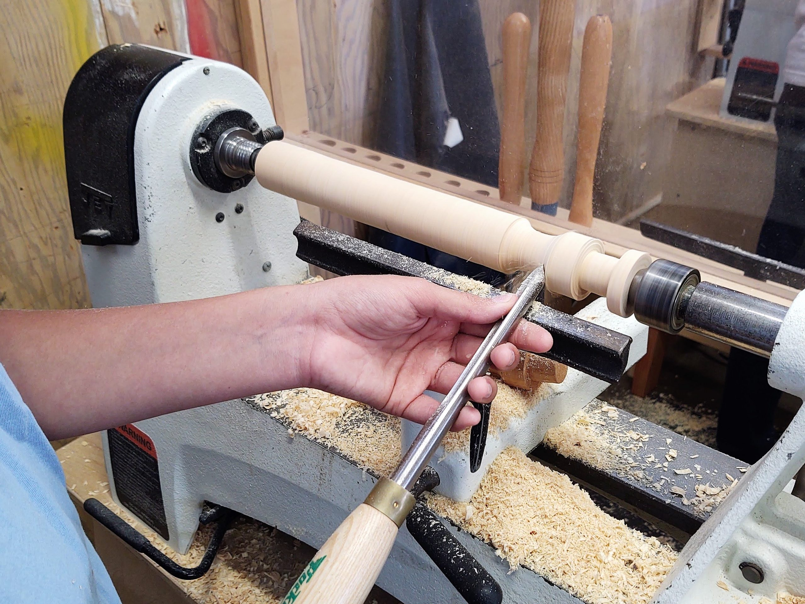 Student starting a candlestick project in woodshop class.