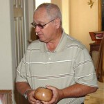 Chuck Stevenson with a potpourri bowl as he described the Wood Carvers' annual Show on Oct. 7th.