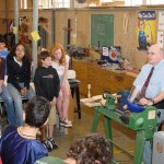 David demonstrating safety at Cabrillo Middle School. The tie, watch and ring were all removed as examples of possible saftey hazzards. The 7th graders make candlesticks as seen in the middle of the photo.