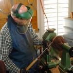 David using swept back bowl gouge to take final shear cut on outside of Natural Edge Bowl