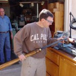 """Tim Albers as President of the Conejo Valley Woodworkers Club was given a giant skew chisel as a """"gift"""". He tries it out on a very small lathe."""
