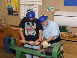 David helping a student with bowl gouge. At the demo each student is encouraged to have a hands on experience.
