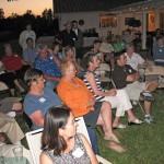 Audience enjoying a perfect evening watching presentation