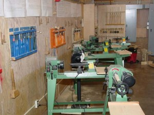 Some of the 7 lathes available for the students. The grinder and jigs were provided by the club.