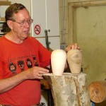 Jim with two hollow forms he turned last week as examples from a log like the one they are sitting on. End grain.