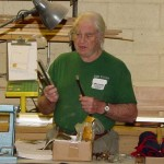 Herm holding Enco boring bars and discussing various sizes of HSS bits available