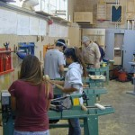 Harvey supervising students at the lathes