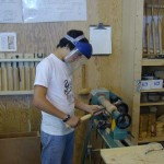 Student roughing out spindle for candlestick