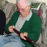 Bob looking at Paulo's new Jerry Glasser line of tools with lead inset rods to vary the weight.