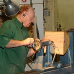 Al mounting an avocado blank for a natural edge bowl; he adjusts the tailstock end so the peaks will be equal at the headstock end which is the top of the bowl