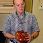 Al with redwood bowl featuring carved rim.