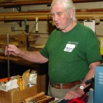 Holding a long rectangular oil-hardening steel bar and some of the many tools he has made