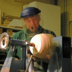 """At the top of the natural edge bowl he is cutting """"air"""" part of the time and we can see thru the valleys and view the headstock."""
