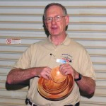 Ron with multple bowls from the same block of wood.