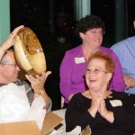 Joe Levy holding the Pecan bowl he received in the gift exchange. It was made by Bruce Purvine.