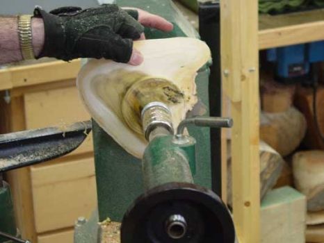 Bowl remounted between centers to remove the glue base and finish the foot.