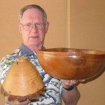 Ron holding two bowls demonstrating their relationship to the position of origin from the log.