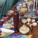 """A small portion of the Show-n-tell table with many 3"""" bowls."""
