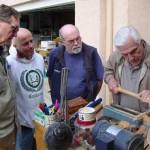 Jim, Paulo, and Doug watching Warren trying a bowl gouge.