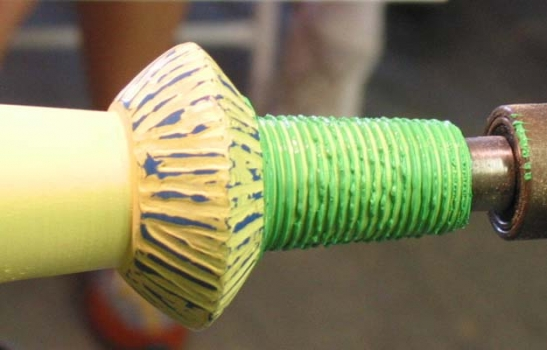 A comb has been run through the thick green gell. The blue is thick streaks of acrylic covered with yellow milk paint and then sanded