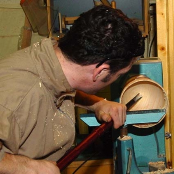 Finishing the bottom of the bowl with a 60 degree bowl gouge.