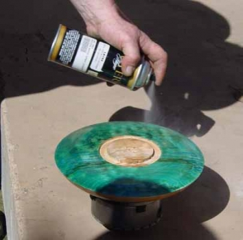 The dyed surface is finished with spray lacquer to seal the dye and prevent bleeding when the rest of the bowl is finished