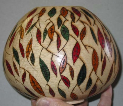 Bowl with burned curved forms colored with thin acylic paint and colored pens