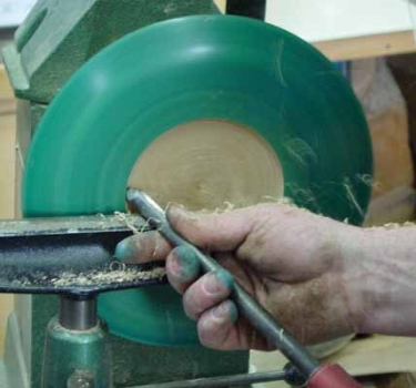 The shallow bowl center is shaped and the inside rim is slightly undercut to remove any dye bleed. The entire bowl then gets 4 coats of spray lacquer