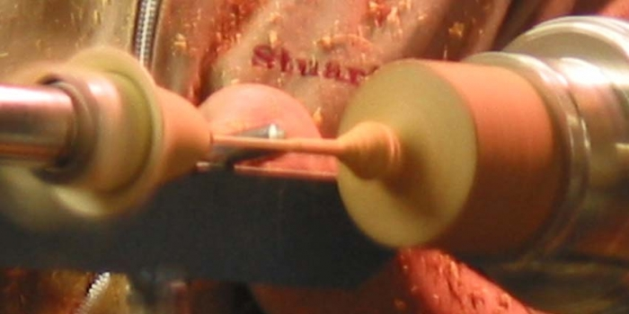 Making the thin stem by progressively removing short sections and thining with the push cut of the bowl gouge.