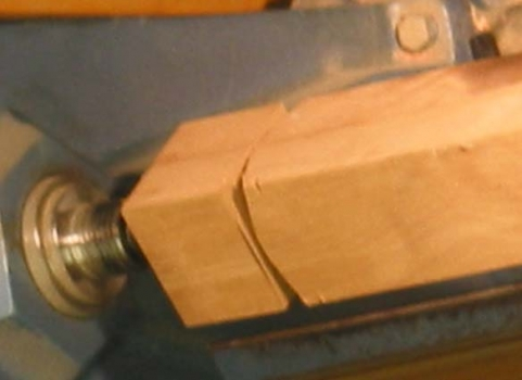 The skew leaves a square junction with the round protion unlike a pommel cut