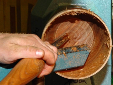 Cutting the inside bottom with blunt angle gouge.