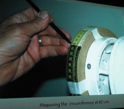 MDF wheel mounted outboard and turned to exact diameter to match # of divisions desired using flexible tape as guide