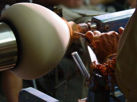 He carefully measures the distance between the end of the tenon at the tail stock and the inside bottom.