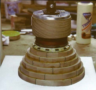 Press glueing one ring at a time on bottom. Bottom surface will be trued on the lathe.