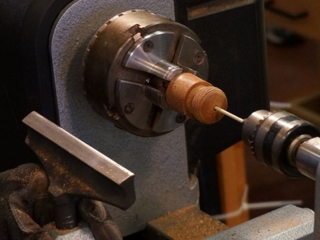 Hold bead in hole with bamboo skewer in tailstock