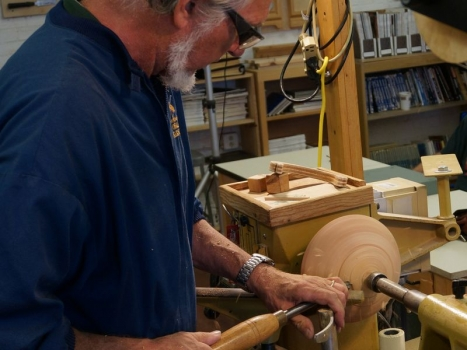 Cutting the bottom tenon for the next coring operation - here held between centers